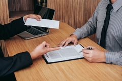 Hand of employer filing final remuneration after employee to write a document letter of resignation, resign concept.  royalty free stock photos