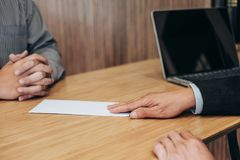 Hand of employer filing final remuneration to employee, letter o. F resignation, resign concept stock images