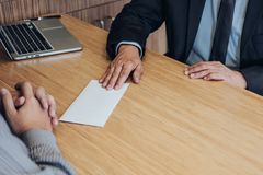 Hand of employer filing final remuneration to employee, letter o. F resignation, resign concept royalty free stock images
