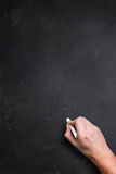 Hand with empty blackboard Stock Images