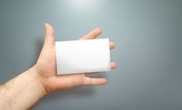 Hand with empty card. Hand with blank card to write your own text Stock Photo