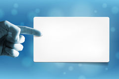 Hand and empty paper card for your text Royalty Free Stock Photos