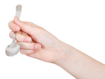 Hand with empty teaspoon isolated Stock Images