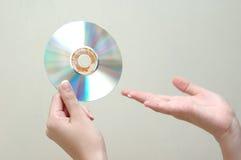 Hand en dvd Stock Foto's