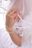 Hand en een bruidssluier Stock Afbeelding