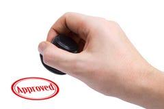Hand en Goedgekeurde rubberzegel royalty-vrije stock foto