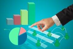 Hand en grafiek Stock Foto's