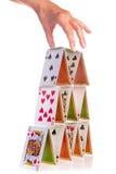 Hand en kaartenhuis Royalty-vrije Stock Afbeelding