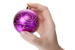 Hand en Kerstmisstuk speelgoed Stock Foto's