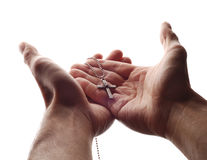 Hand en kruis stock foto