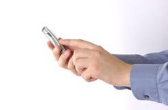 Hand en mobiel stock foto