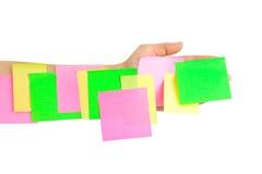 Hand en multicolored notadocument Stock Afbeelding