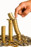 Hand en muntstukken Royalty-vrije Stock Afbeeldingen