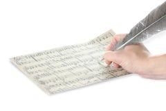 Hand en muziekblad stock afbeeldingen