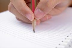 Hand en potlood Stock Afbeelding