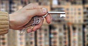 Hand en sleutels i Stock Fotografie