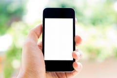 Hand en telefoon Stock Afbeeldingen