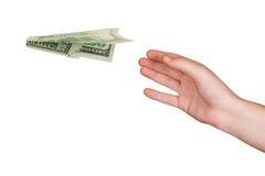 Hand en vliegend geldvliegtuig stock foto