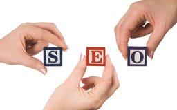 Hand en woord SEO Royalty-vrije Stock Afbeeldingen