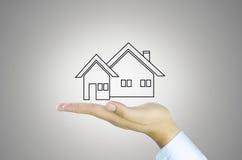 Hand en zoet huis Stock Foto