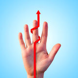 Hand encircled by red arrow showing growing increase. Man hand encircled by red arrow showing growing increase Stock Photography