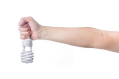 Hand with energy saving lamp on white background Royalty Free Stock Photography