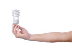 Hand with energy saving lamp on white background Stock Images