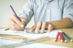 Hand of engineer or architect project drawings by color pencil. Stock Photos