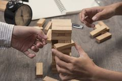 Hand of engineer point a blocks wood tower game. concept prevent Stock Image