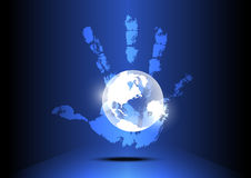 Hand engulf the world Stock Images