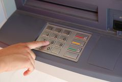 hand enter the secret code on the keypad of the ATM to withdraw Royalty Free Stock Image