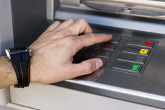 Hand entering personal identification number on ATM Royalty Free Stock Photography