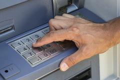 Hand entering pin at ATM machine Royalty Free Stock Images