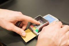 Hand entering pin code to bank terminal Royalty Free Stock Photo