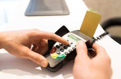 Hand entering pin code to bank terminal Royalty Free Stock Image