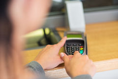 Hand entering pin code to card reader terminal Stock Photography