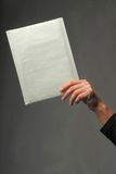 Hand with an envelope Stock Photos