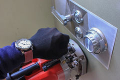 Hand equipment and tools stealing a deposit box. Stock Images