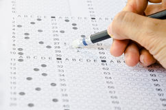 Hand erase wrong answer on Exam . Royalty Free Stock Image