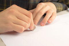Hand with eraser Stock Photography