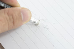 Hand with eraser. Eraser Correction notebook, written with a pencil Royalty Free Stock Image