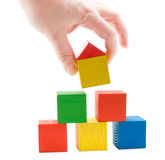 Hand establishes toy house Royalty Free Stock Photo