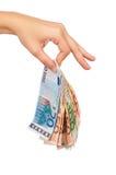 Hand with euro Stock Photos