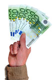 Hand with euro banknotes. Hand holding 100 euro banknotes, isolated over white Royalty Free Stock Photography