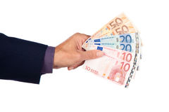 Hand with euro banknotes. Male hand with euro  banknotes on a white background Stock Photos
