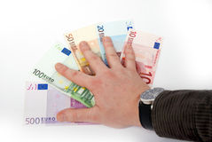 Hand on Euro banknotes Royalty Free Stock Image