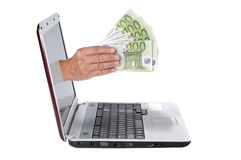 Hand with euro banknotes comes from the laptop screen Royalty Free Stock Photo