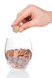 Hand with 2 euro coin and glass with euro cents Stock Image