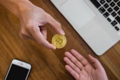 Hand exchange golden metal Bitcoin crypto currency investment- s royalty free stock photos