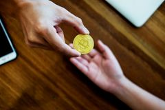 Hand exchange golden metal Bitcoin crypto currency investment- s stock images